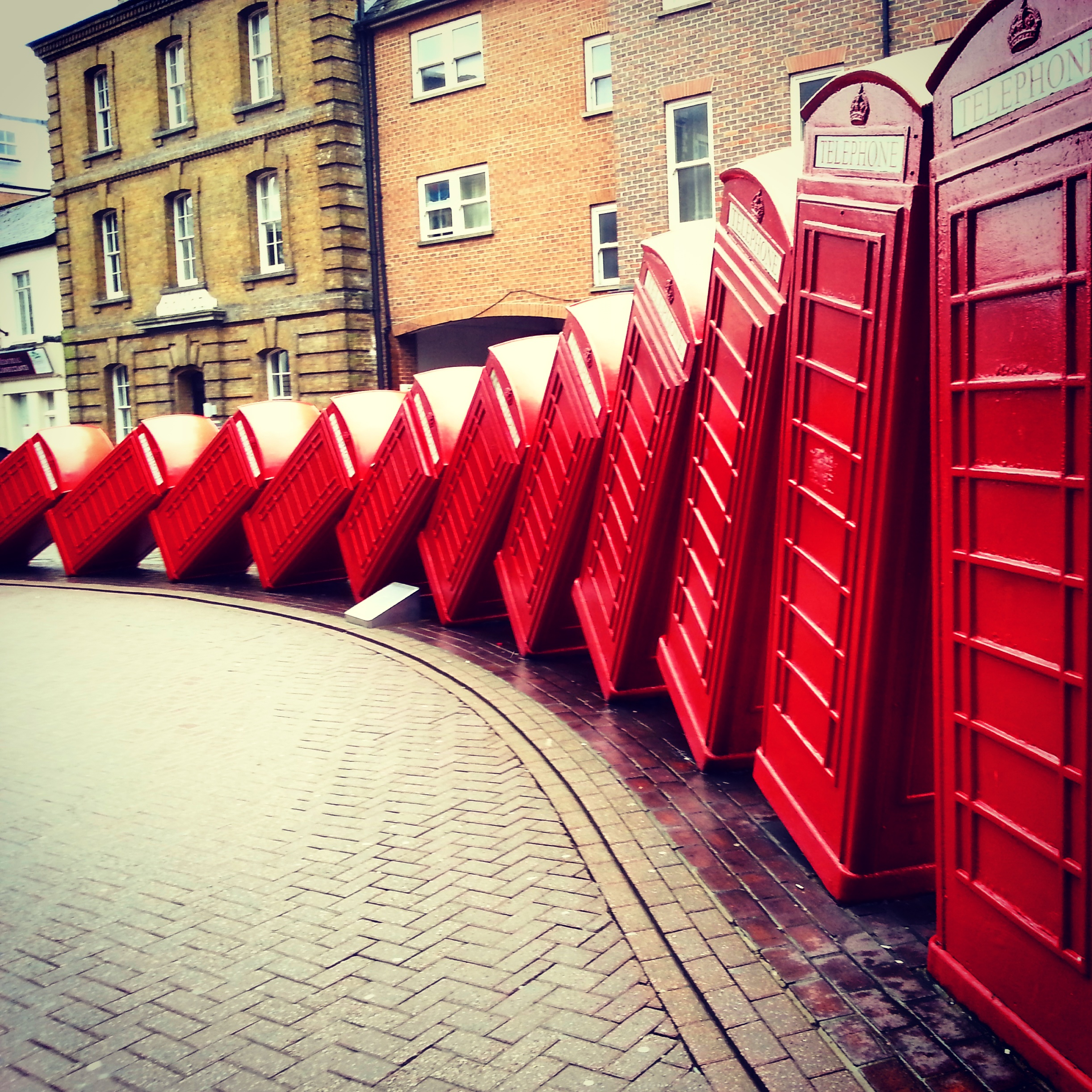 Leaning telephone boxes - art